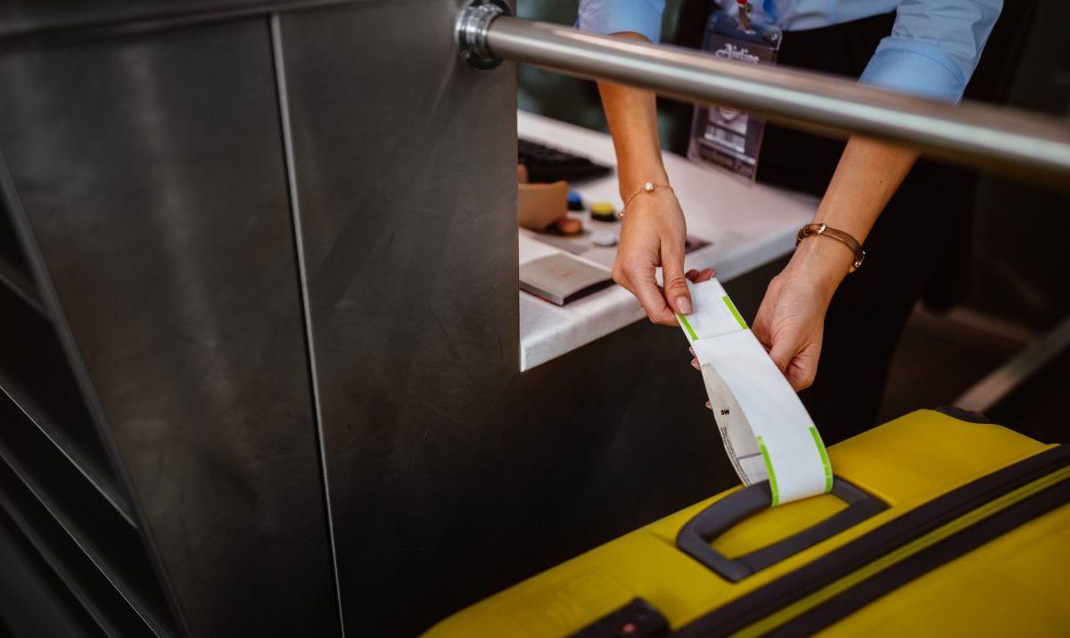curbside baggage handlers check bags