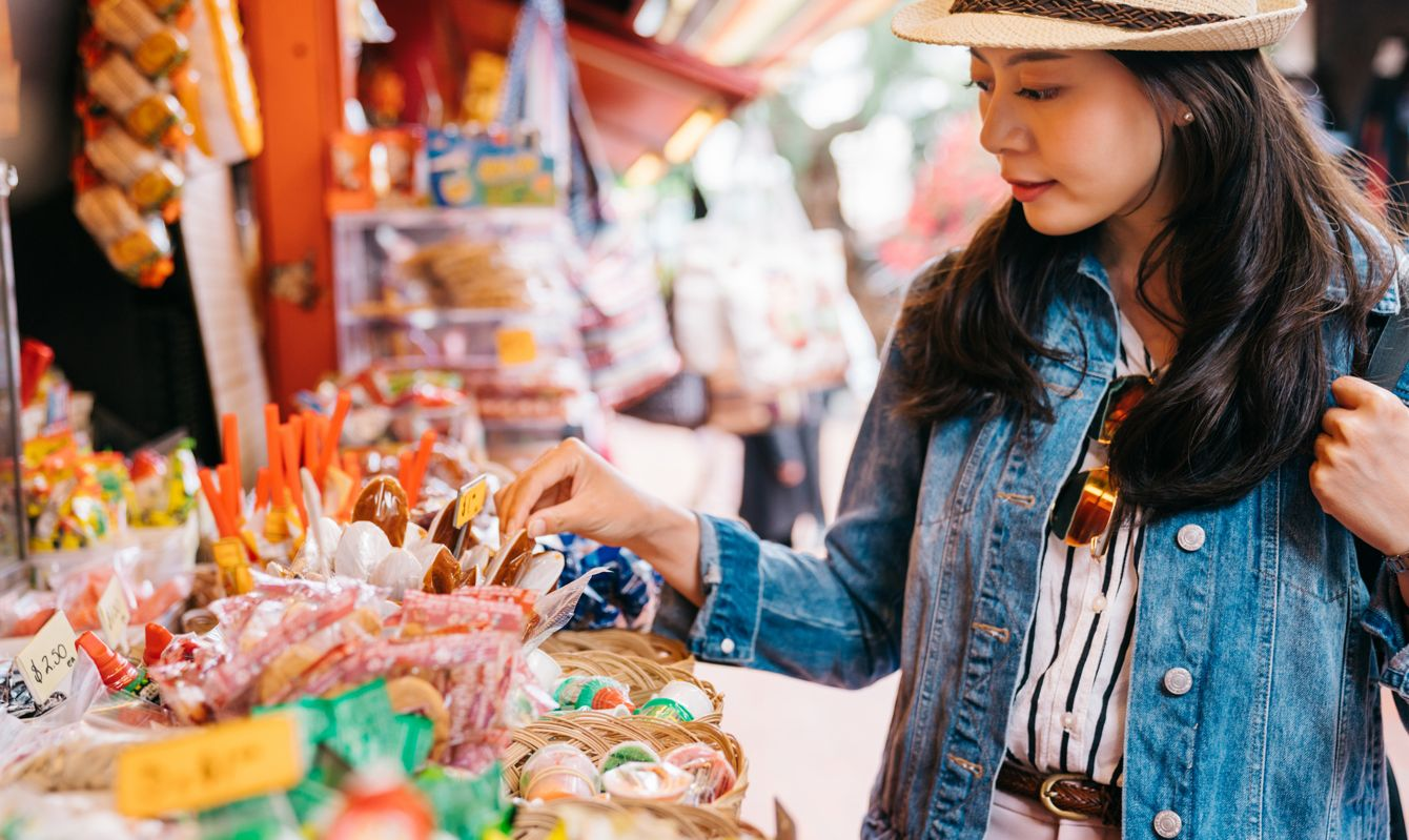 traveler looking at the specialties in Mexican outdoor vendors. travel in America lifestyle.
