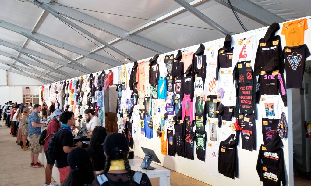 Festivalgoers are seen at the Merchandise Tent during the 2019 Coachella Valley Music And Arts Festival