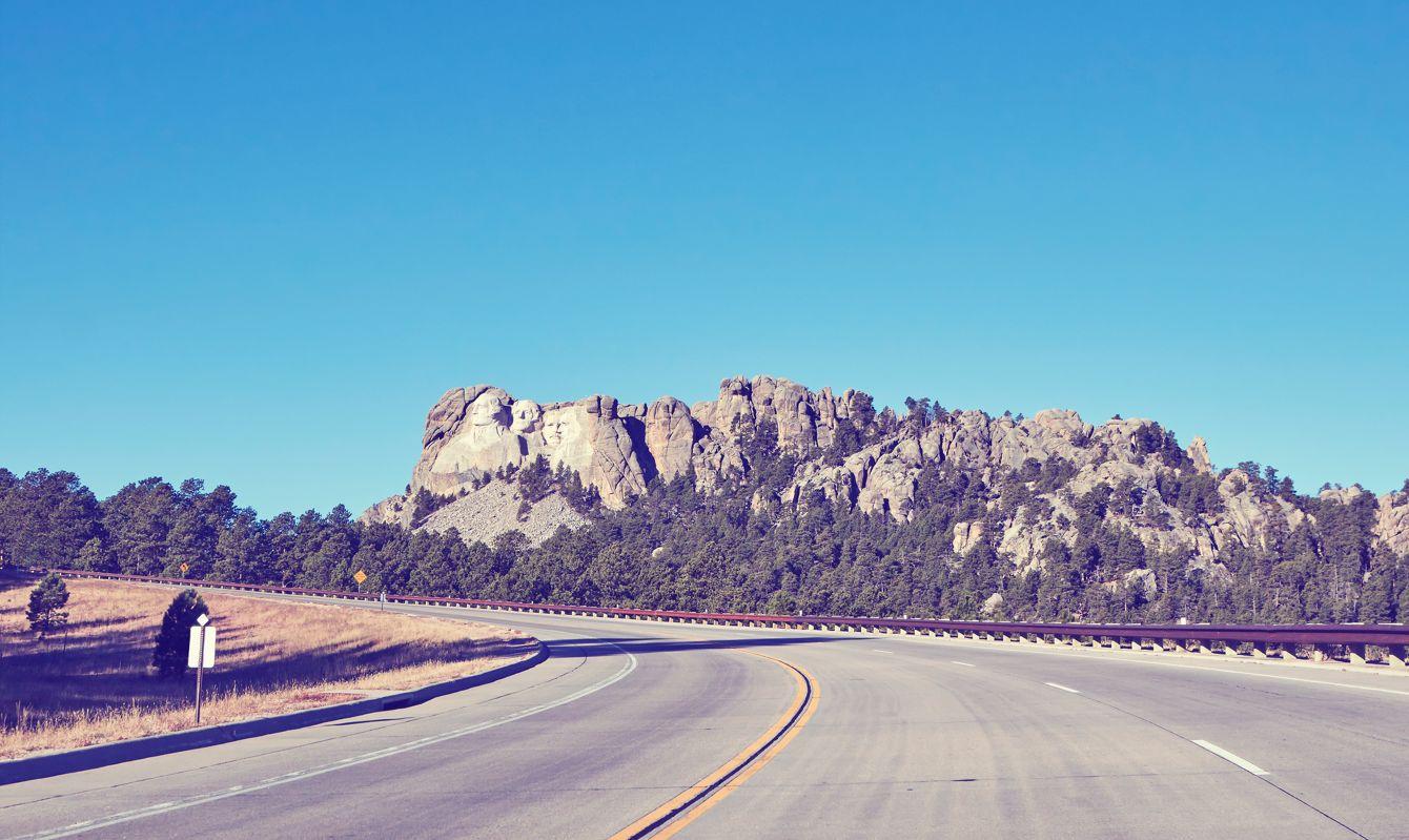 Retro color toned road to Mount Rushmore National Memorial, South Dakota, United States.
