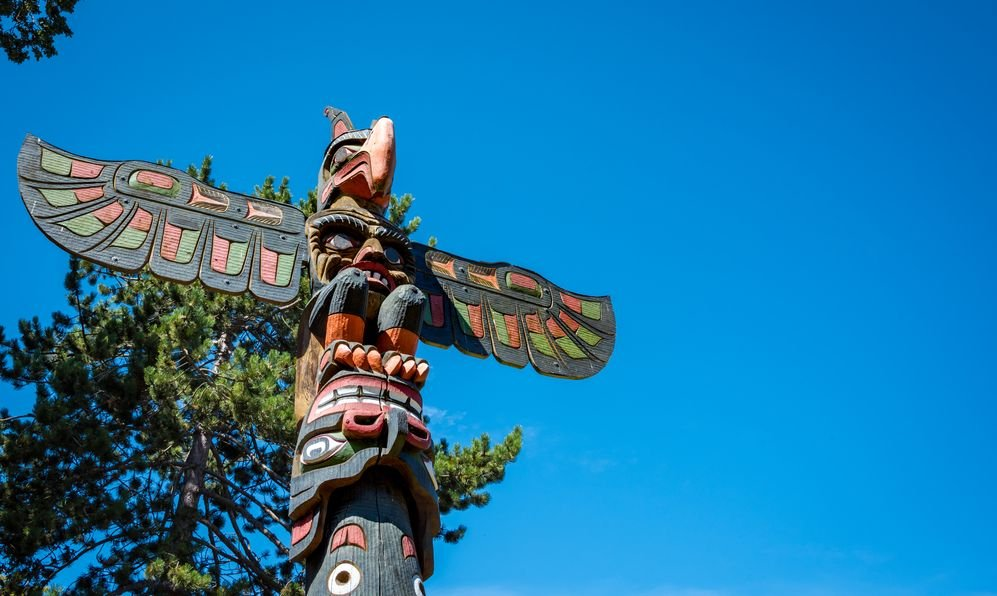 First Nations carved totem pole found in the popular tourist attraction, Thunderbird Park