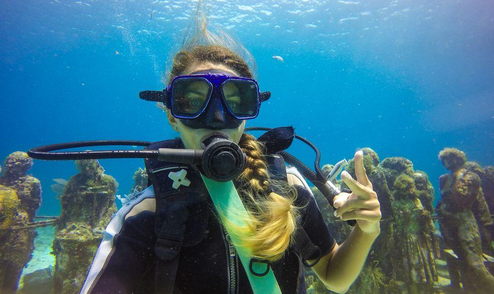 woman is diving in the ocean