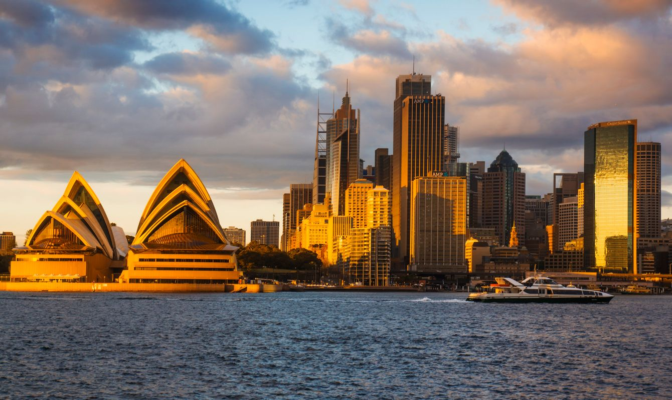 Sydney's skyline turns gold at sunrise.