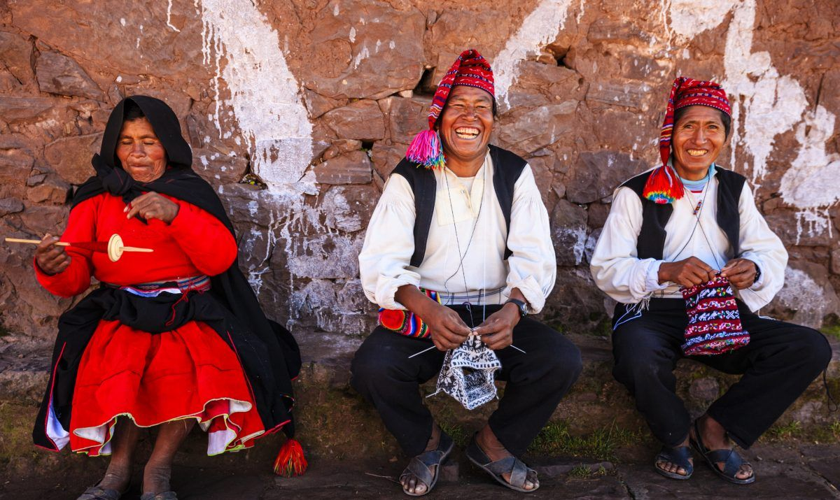 Men do the knitting and intricate embroidery of clothing on Taquile Island