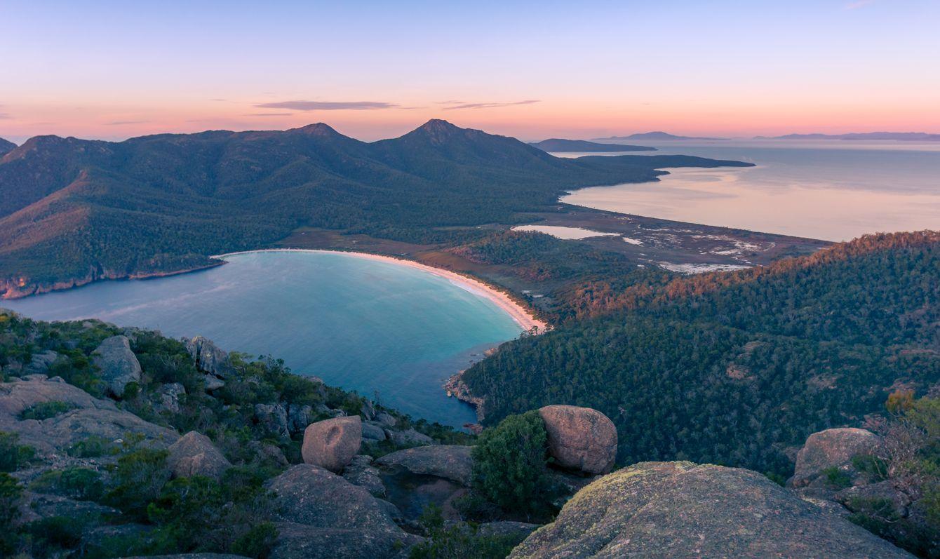 Sunrise landscape of beautiful bay and mountains. Wineglass bay in Freycinet National Park, Tasmania, Australia