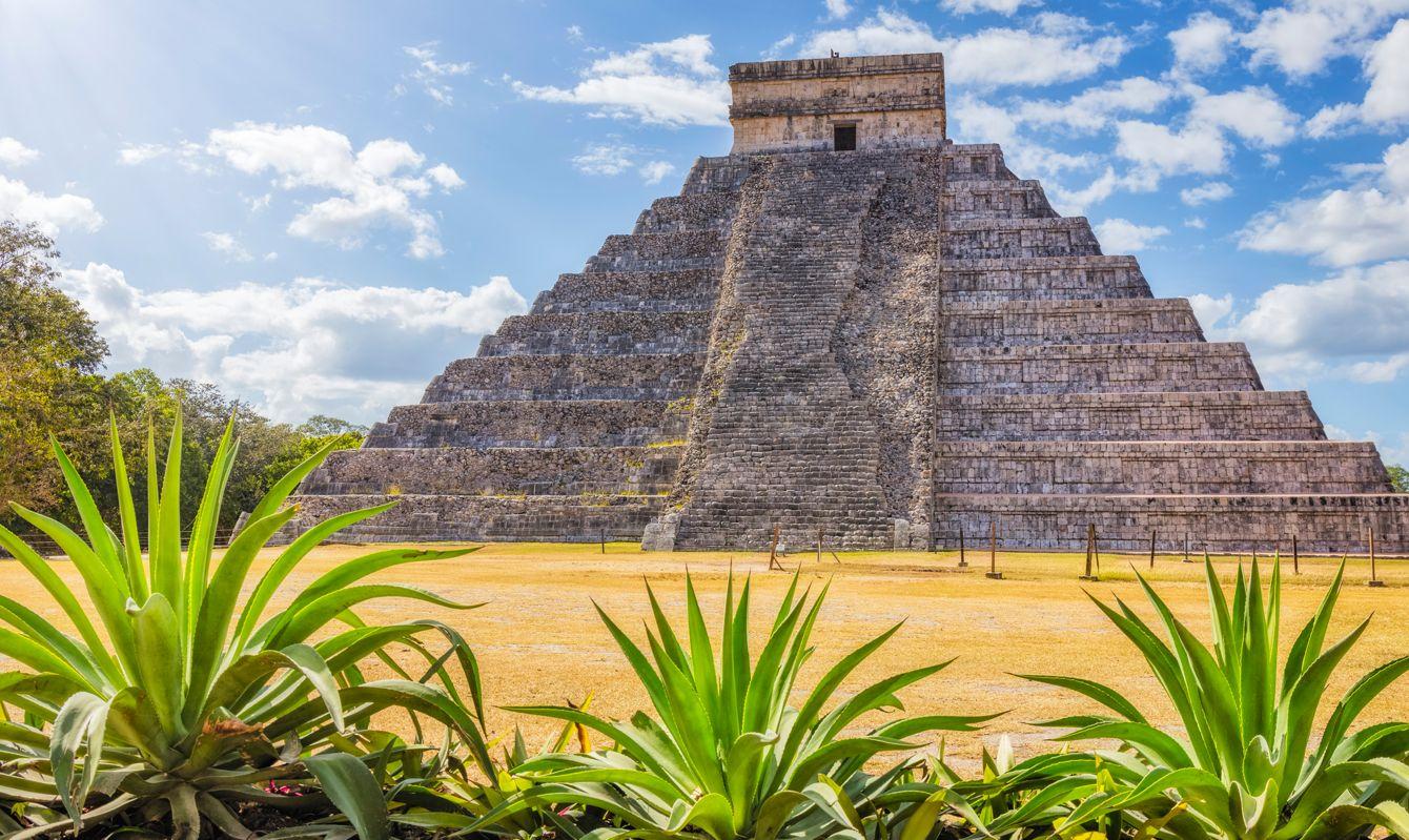 Sunny Archaeological site Kukulkan / El Castillo , Mayan Pyramid Chichen Itza Mexico