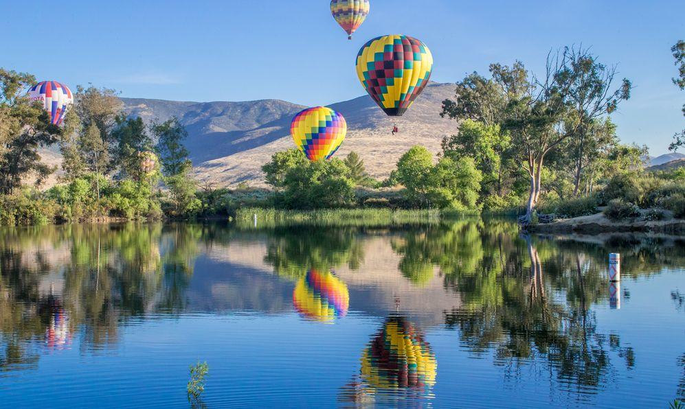 Four hot air balloons across the horizon in Temecula