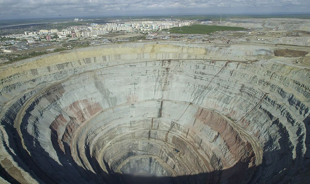 "The eastern Siberian city of Mirny hovers near the edge of the Mir (Peace) diamond mine August 30, 2001, one of the largest mines run by Russia''s state diamond company, Alrosa. The mine produces some of the highest quality stones in Russia, known as ""Mir diamonds."" Russia produces one-quarter of the world''s diamonds."