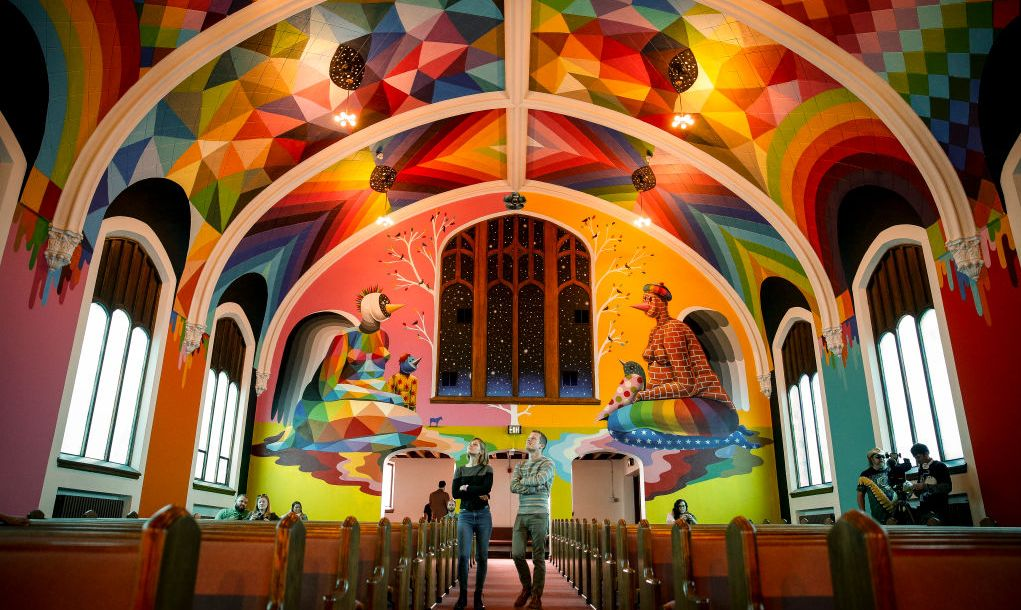 DENVER, CO - APRIL 20: Visitors check out the artwork at the opening of the International Church of Cannabis in Denver, Co. on April 20, 2017. The opening coincides with 420 Day celebrations advocating for the legalization of cannabis nationwide and church goers subscribe to Elevationism, a loosely interpreted religious belief that claims cannabis use as a sacrament. The artwork in the chapel was painted by Spanish artist Okuda San Miguel.
