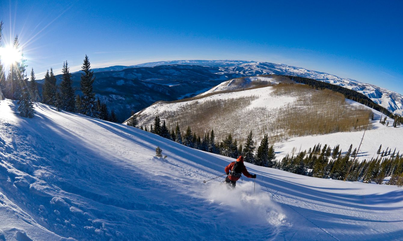 Skiing at Sunset Fisheye View Looking Down Mountain Scenic Angle.