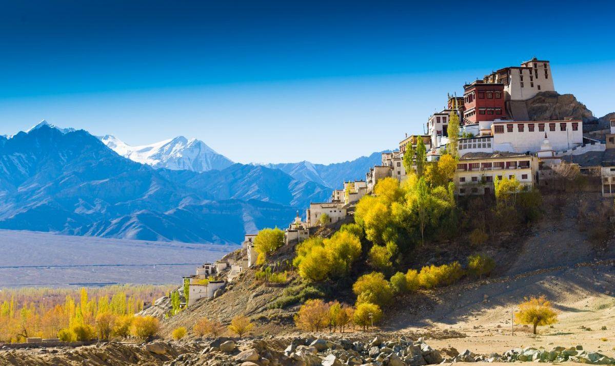 Prayer flag in Tsemo castle with beautiful mountain snow landscape background in Leh Ladakh