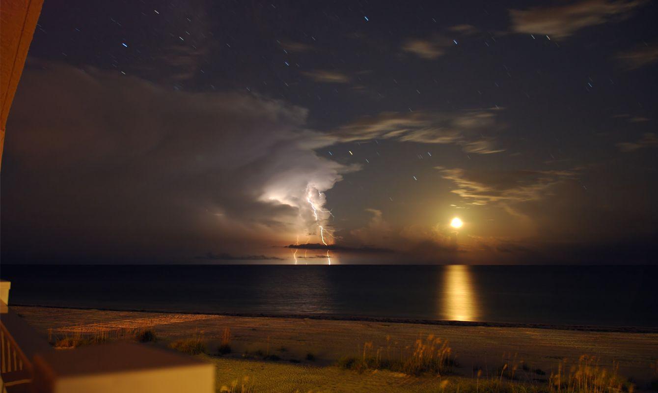 Moon Lightning above the ocean at night