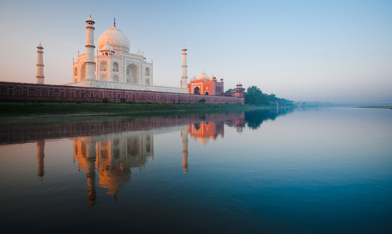 A beautiful sunrise lights the side of the Taj Mahal early morning from the