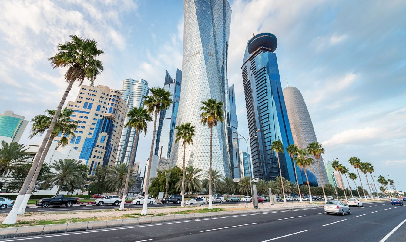 Famous Corniche, the waterfront street along Doha Bay, with its futuristic skyscrapers.