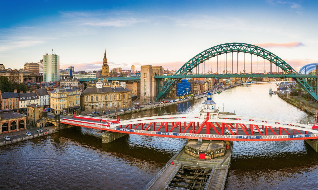 Taken at sunset, a view looking down the River Tyne in central Newcastle. The Swing Bridge, Tyne Bridge and Gateshead Millennium Bridge over the river are visible.