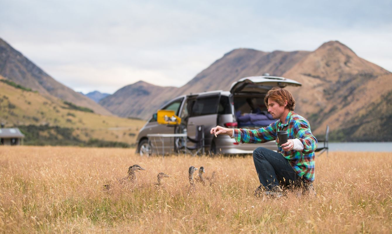 Campers settle at a campsite alongside Lake Moke, just outside of Queenstown.