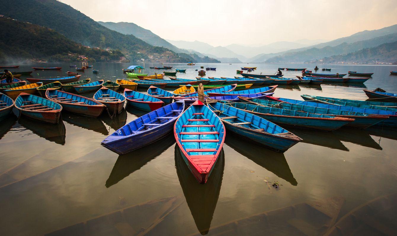 twilight with boats on Phewa lake, Pokhara, Nepal