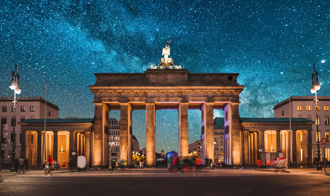 Brandenburg Gate in Berlin, Germany, at night, under a beautiful starry sky