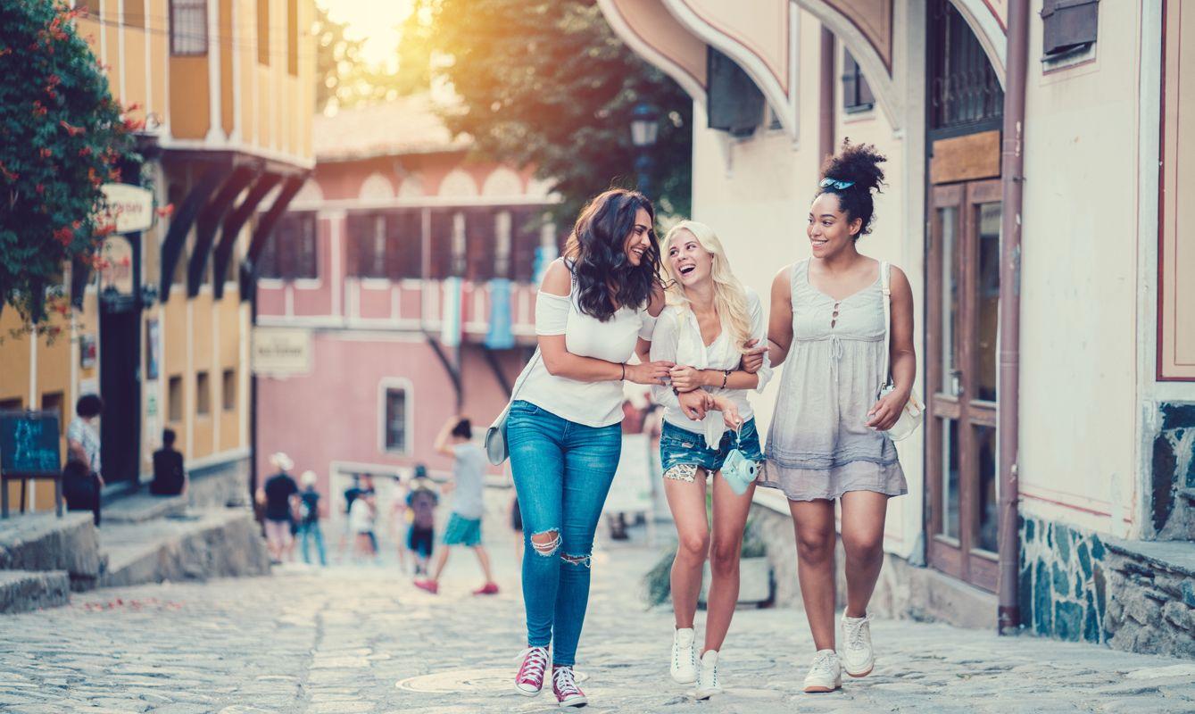 Three girls enjoying new city together