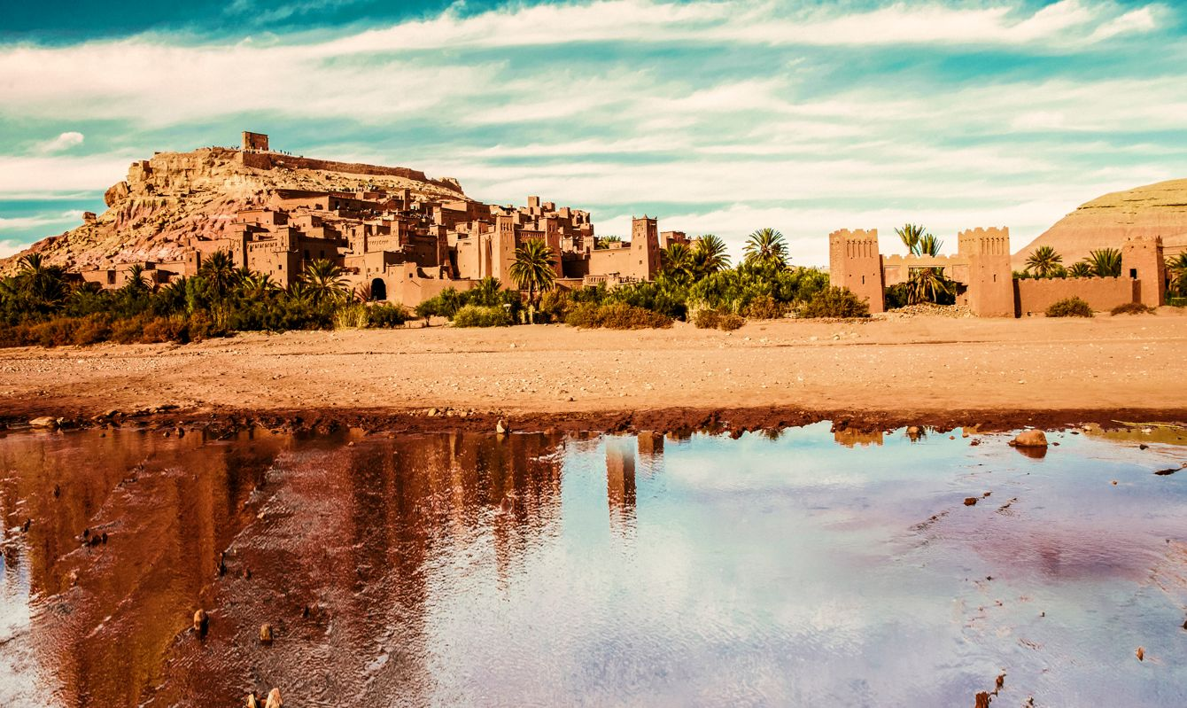 Ait Benhaddou surrounded by palm trees and desert