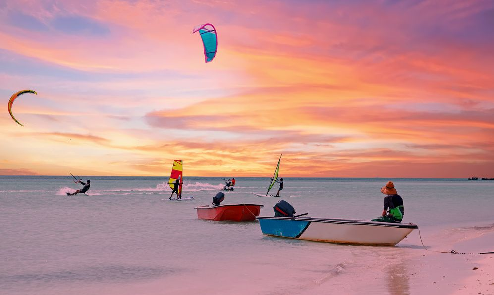 Watersports at Palm Beach on Aruba island in the Caribbean Sea at sunset