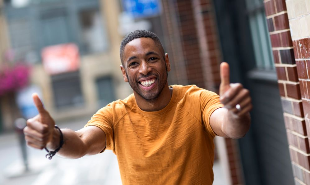 man giving thumbs up insult overseas