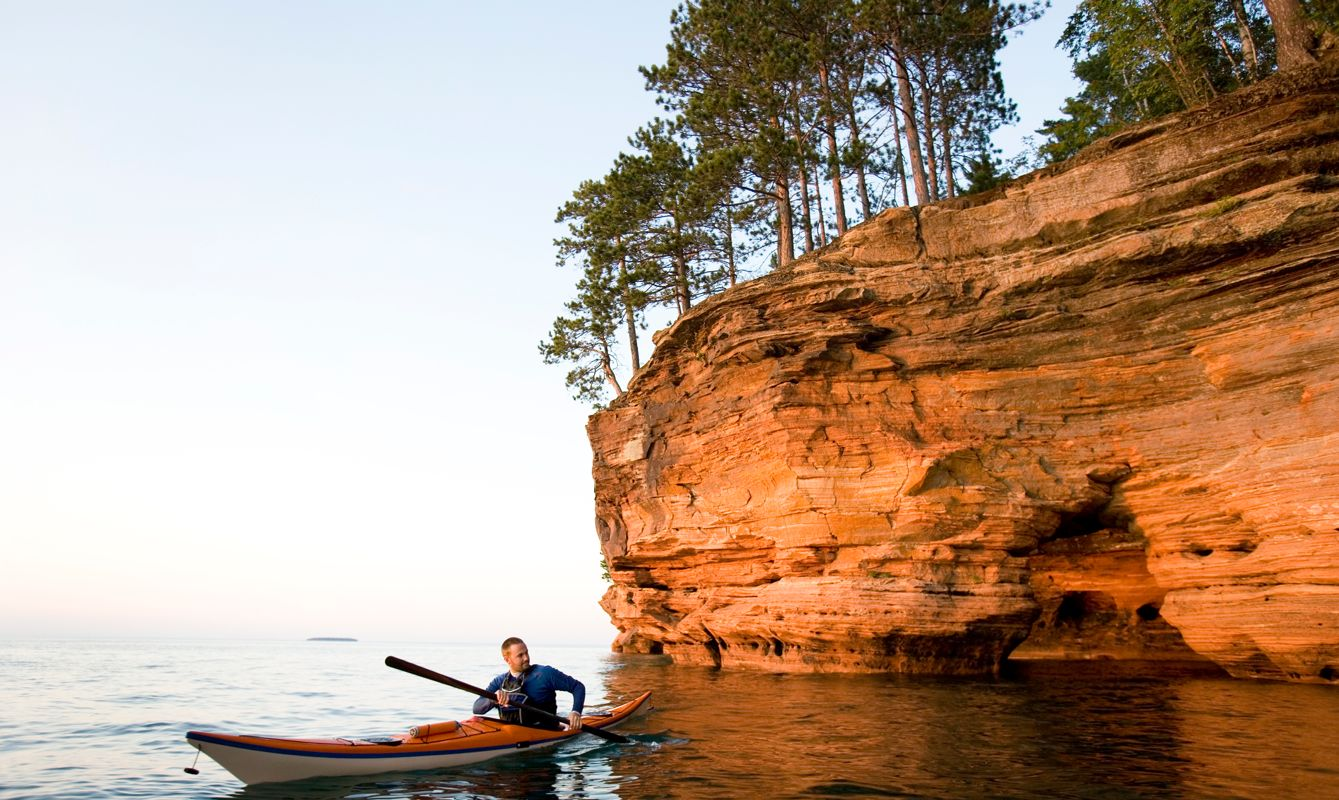 Man Sea Kayaking in The Apostle Islands National Lakeshore.
