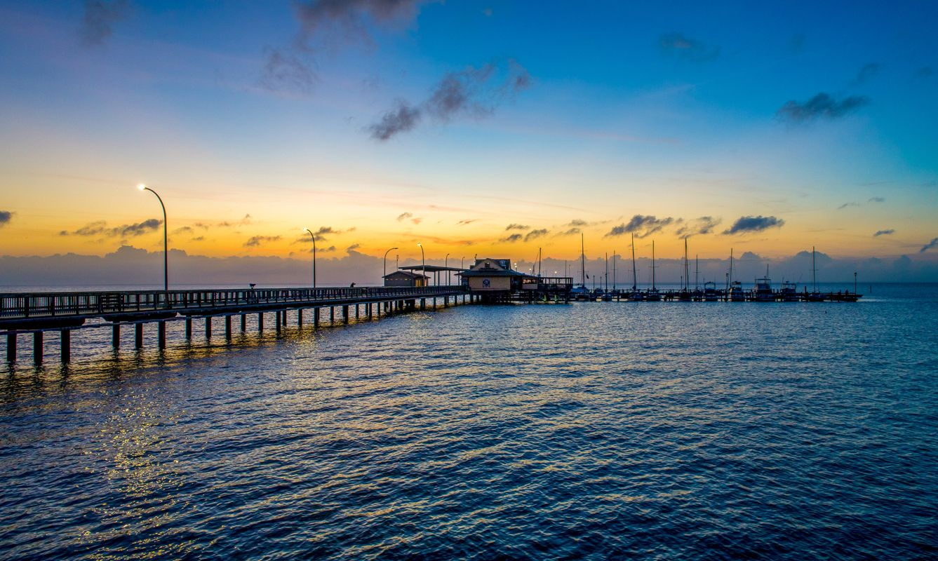 The Fairhope pier and Mobile Bay at sunset on the Alabama Gulf Coast