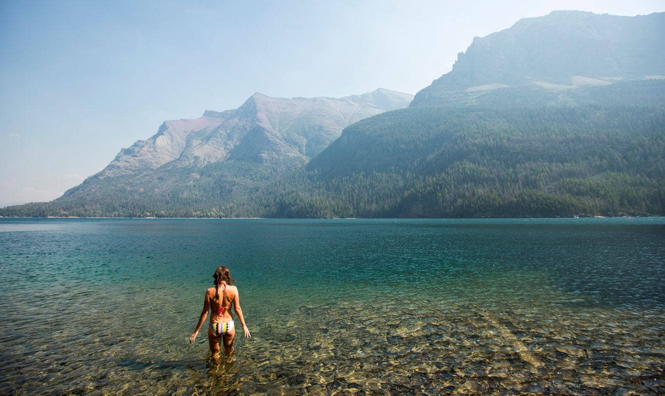 A woman swimming in St. Mary Lake in Glacier Park.