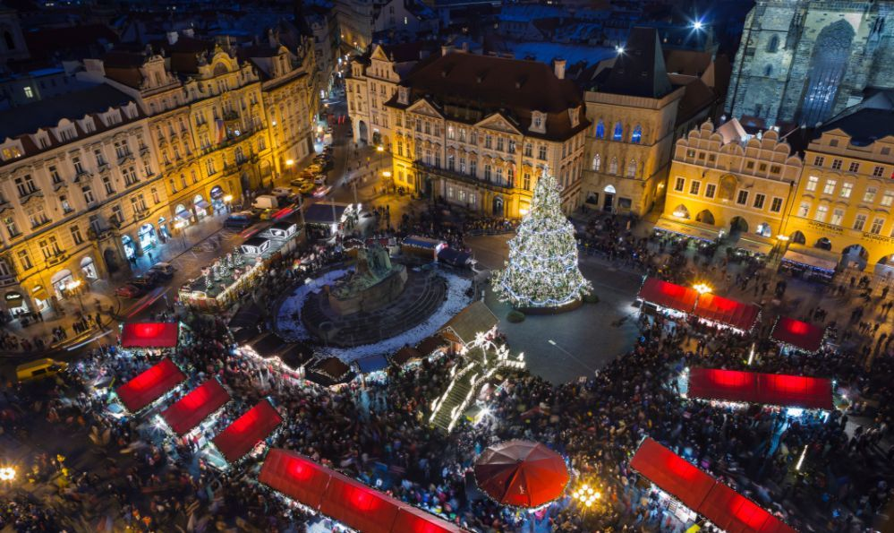 a Christmas market in a square in Prague