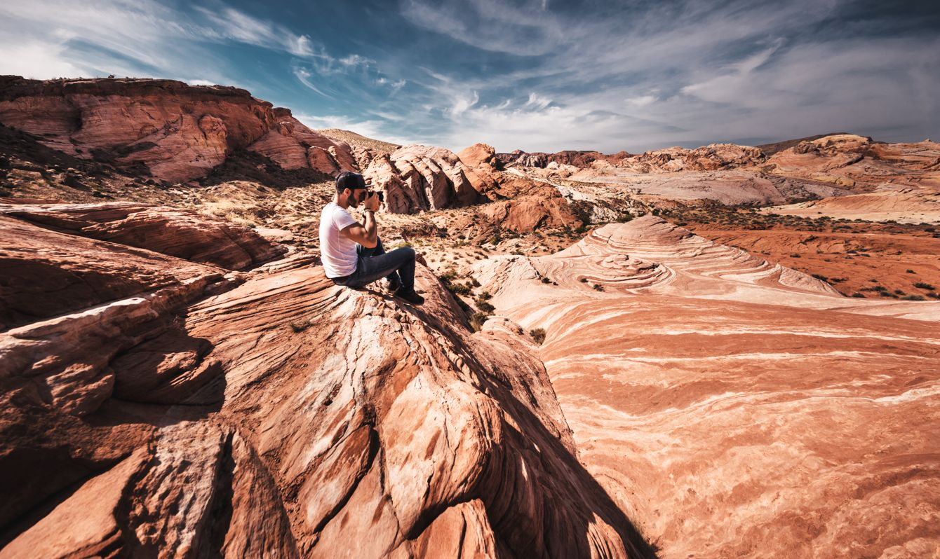 man hiking on the valley of fire state park
