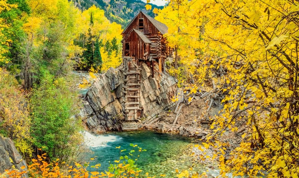 The abandoned Crystal Mill also known as Dead Horse Mill is in the Gunnison National Forest. Crystal River flows next to the mill and drops into a pool.