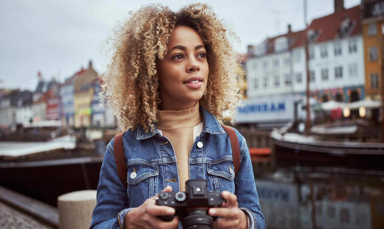 Shot of an attractive young woman out with her camera in a foreign city