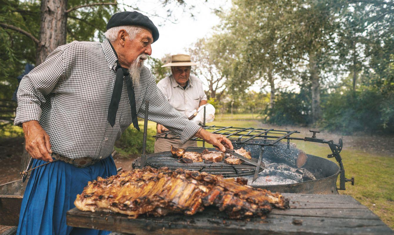 Men preparing a rib barbecue in the firewood