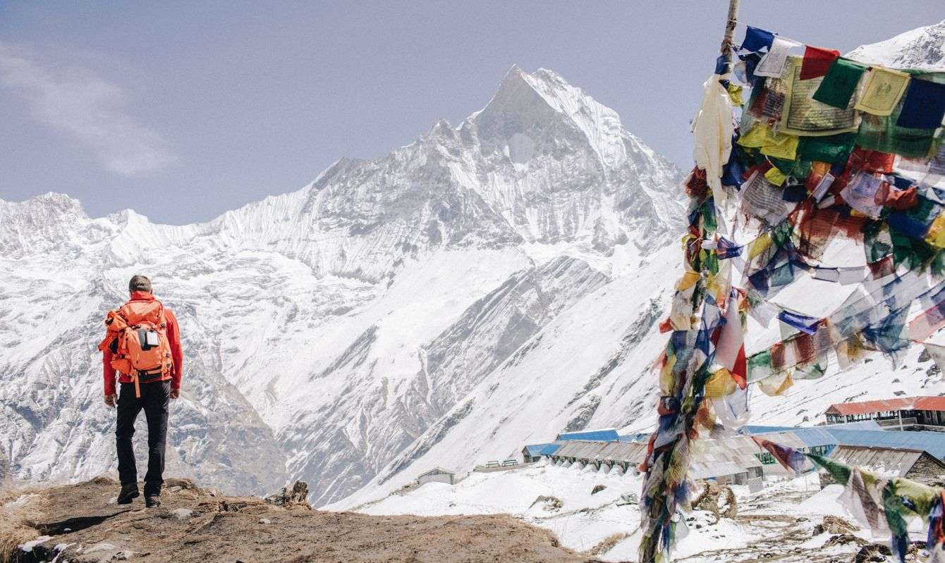 Photo of a proud hiker who has conquered one of the mountains of Annapurna Range on Himalayas, Nepal