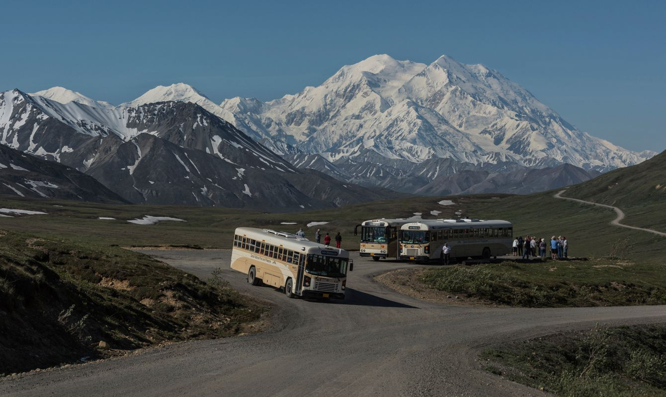Wildlife Tour Buses, stop at Stoney Mountain to give visitors a look at the largest Mountain in North America, 20,320 ft Mt. Denali, Denali National Park, Alaska.