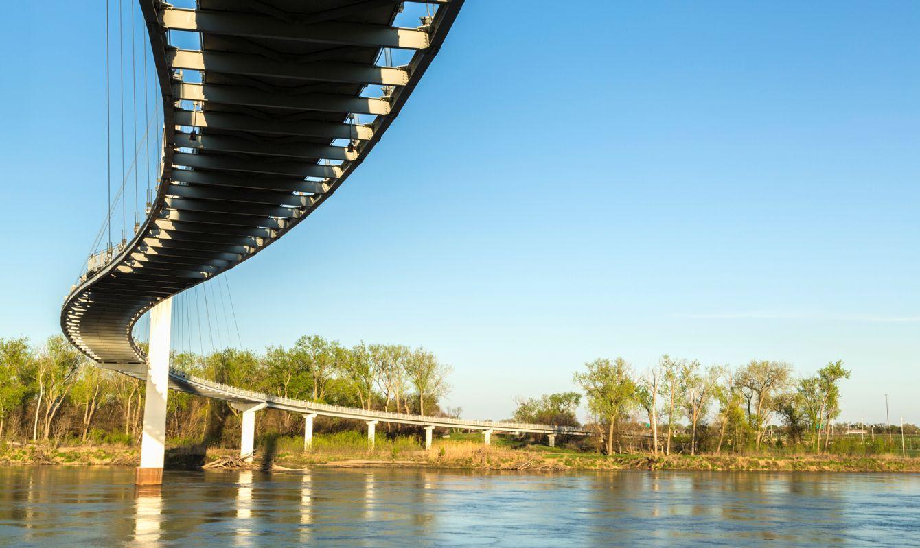 The Bob Kerrey Pedestrian Bridge is a curvaceous 3,000-foot footbridge across the Missouri River linking Council Bluffs, Iowa, and Omaha, Nebraska.