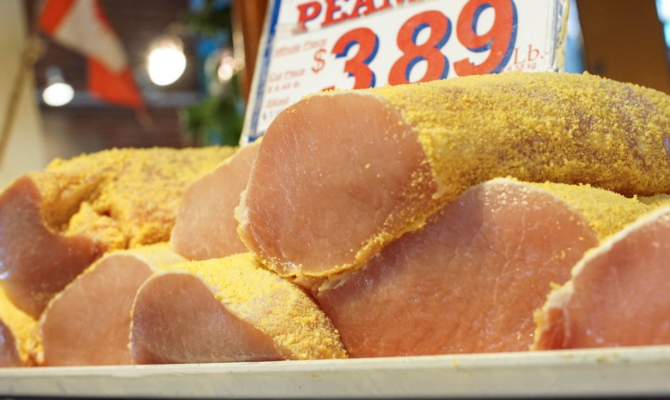 fresh slabs of Peameal bacon at a farmers market