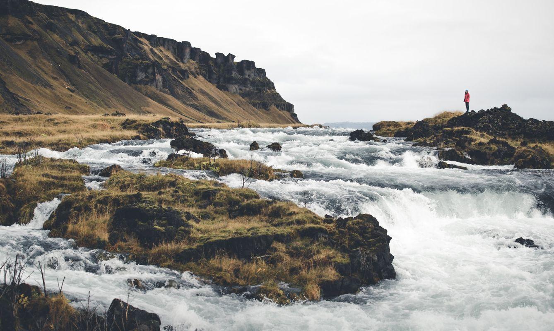 Solo tourist near waterfalls in Iceland