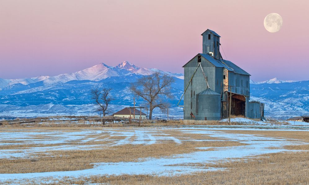 A Colorado Abandon Grain Mill at Sunrise along the Mountain Range with Long's Peak prominent in the background