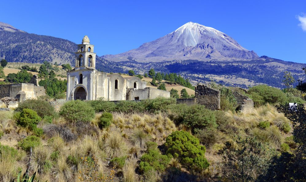 Church and Pico de Orizaba volcano, or Citlaltepetl, is the highest mountain in Mexico, maintains glaciers and is a popular peak to climb along with Iztaccihuatl and other volcanoes in the country
