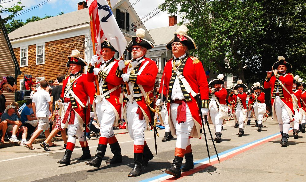 July 4 Adults dressed in British red coats from the American Revolution, march in a fourth of July parade in Bristol, Rhode island