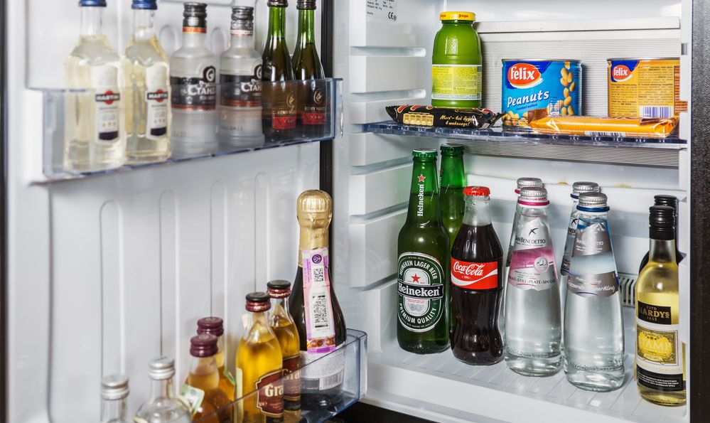 mini bar with soft drinks, vodka, wine and beer in the hotel room