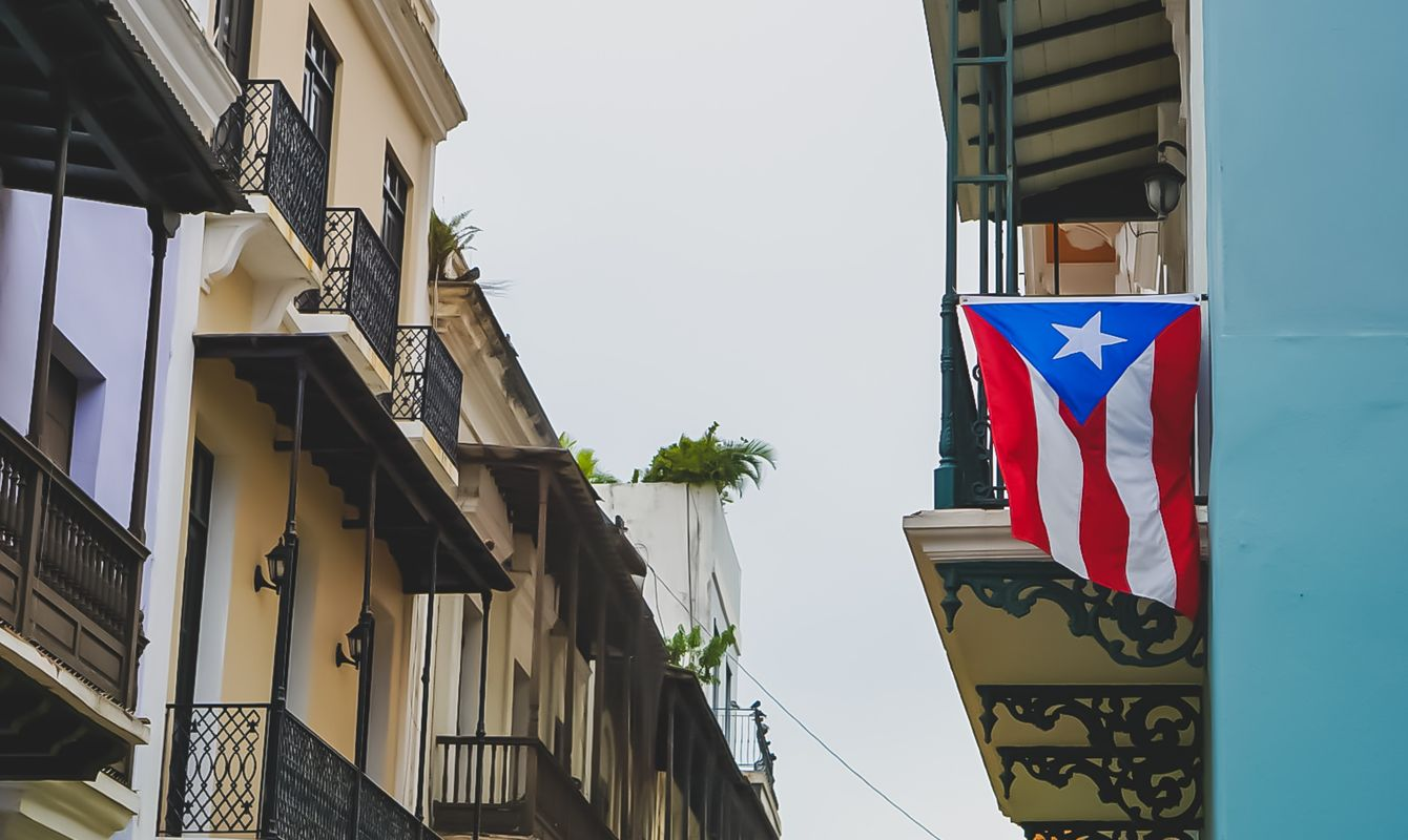Puerto Rican flags hanging from a balcony
