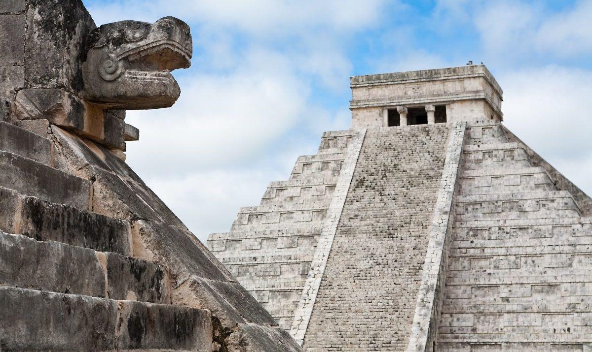 Ancient Mayan Serpent's Head And Pyramid At Chichen Itza