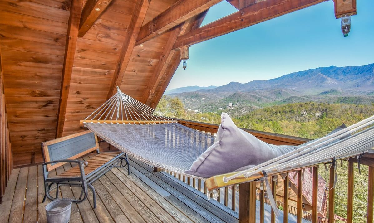 hammock on a lovely deck with a wooded view
