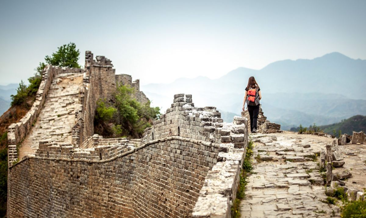 Woman Walks Along The Great Wall Of China