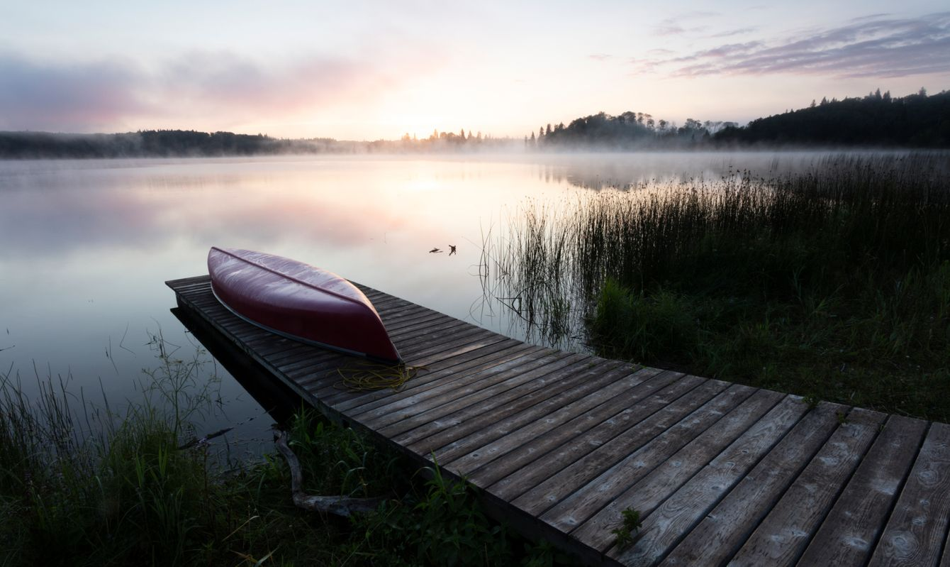 Canoe resting on a dock at Riding Mountain National Park Manitoba Canada