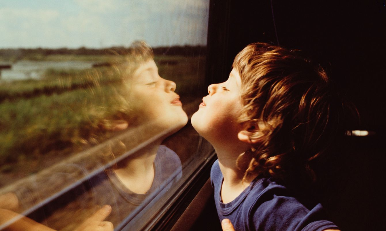 Child and Reflection in Window