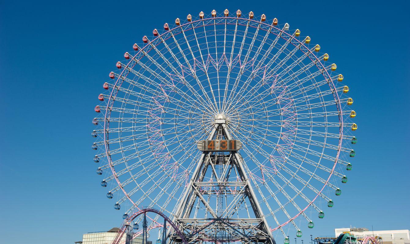 Giant Ferris wheel Cosmo clock against a blue sky located at Minato Mirai in Yokohama near Sakuragicho station